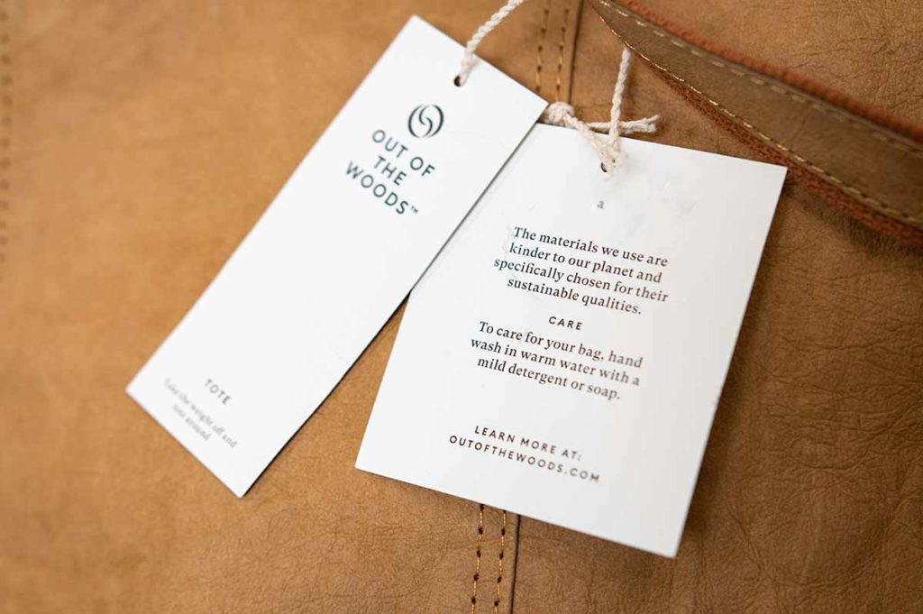 Out of the Woods Supernatural Paper Tote Bag material tags.
